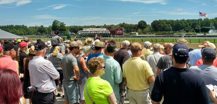 a crowd looks on at the race track