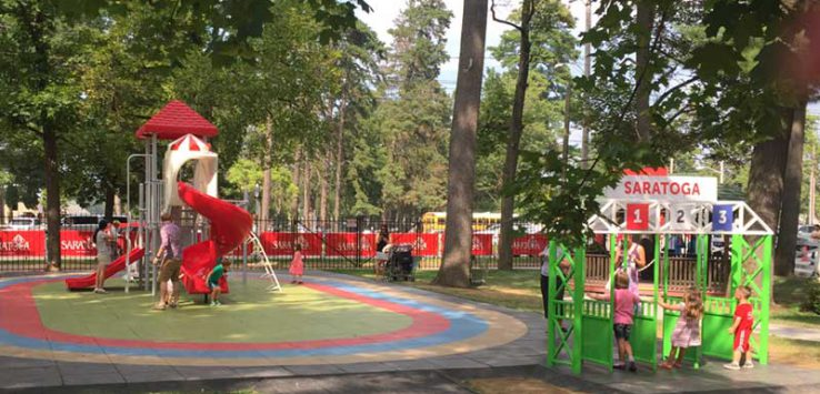 Kids play at the Saratoga Family Zone playground at Saratoga Race Course