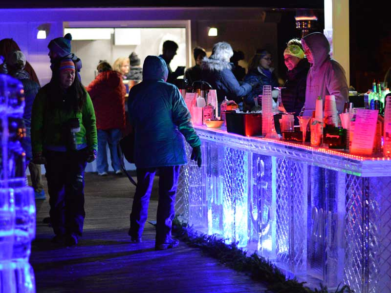 An ice bar filled with patrons in Lake George