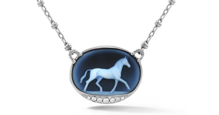 a blue pendant with a horse image
