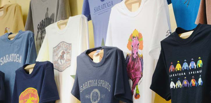 saratoga shirts on a wall