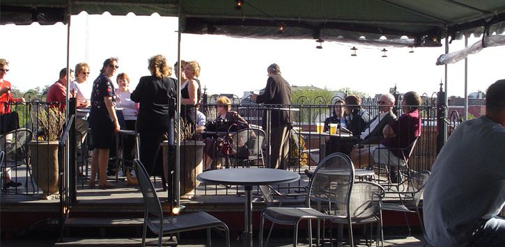 outdoor patio with people at Saratoga City Tavern